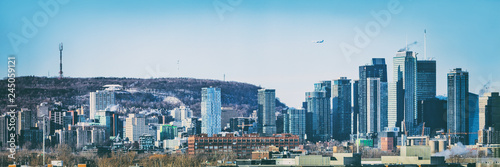 Montreal city skyline panorama of Quebec travel destination in Canada. Winter scenery background of mount royal mountain and skyscrapers buildings downtown.