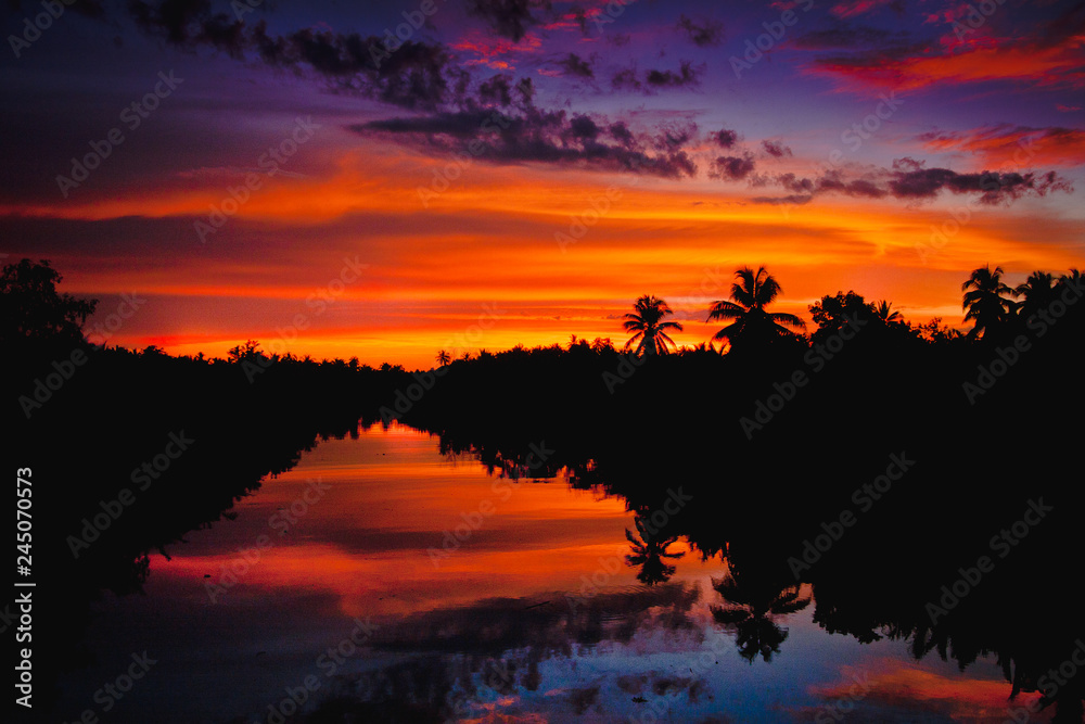 Fototapety, obrazy: colorful sunset with clouds light rays over the river with reflections on silhouette nature landscape background