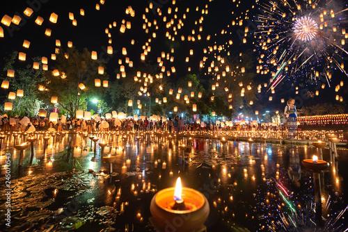 Fotografie, Obraz  Thousands of Floating Lanterns, People and Fireworks in Yee Peng or Loy Krathong