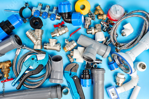 Fotografía  plumbing tools and equipment on blue background top view.