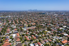 Aerial View Of Houses In The Melbourne Suburb Of Preston Victoria On A Summers Day. The City Of Melbourne Can Be Seen In The Distance.