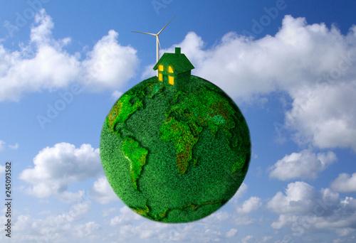 Fotografía  Environmental energy concept of house and wind turbine on grass globe