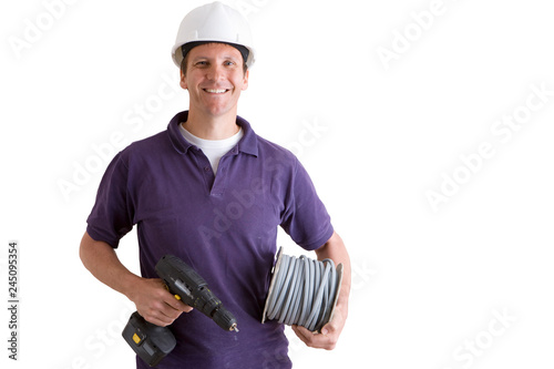 Studio cut out of smiling electrician with drill and cable on white smiling at camera
