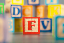 Photograph Of Colorful Wooden Block Letter F