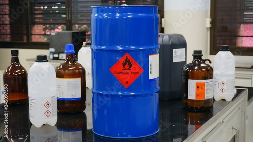 Fotografie, Obraz  Blue color hazardous dangerous chemical drum barrels with red flammable liquid w