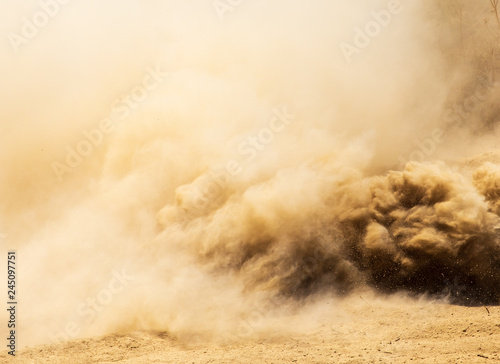 Foto Dust cloud on nature as background