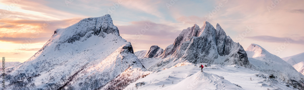 Obraz Panorama of Steep peak mountains with covered snow and mountaineer man backpacker fototapeta, plakat