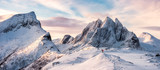 Panorama of Mountaineer standing on top of snowy mountain range