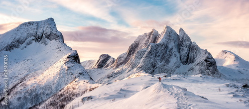 Panorama of Mountaineer standing on top of snowy mountain range - 245101126