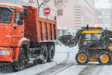 Excavator Load Snow In Truck. ...