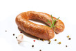 Sausage with herbs and spices on a white background