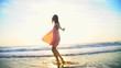 Beautiful Caucasian American girl on leisure vacation beach at sunrise