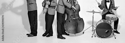 Fotografia Jazz band players on white. Vintage music background