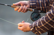 Hands Tying Flies And Casting Close Up