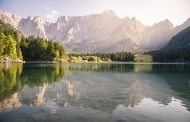 Superior Fusine Lake with Mount Mangart on the background. Fusine Lakes Natural Park, Tarvisio, Udine province, Friuli Venezia Giulia, Italy.