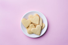 Homemade Cookies In The Shape Of A Heart On A Pastel Pink Background. Copy Space. Concept Valentine's Day