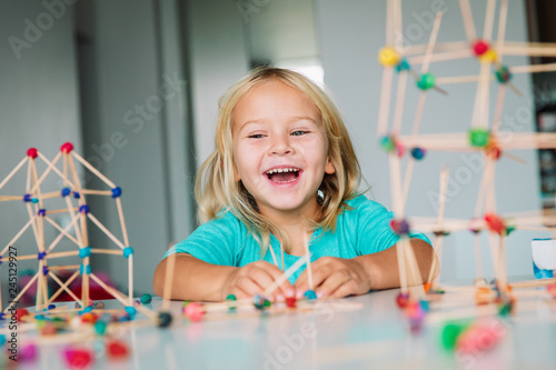little girl making geometric shapes, engineering and STEM