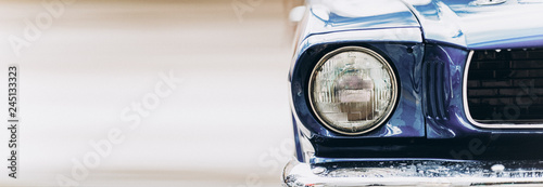 Foto auf AluDibond Oldtimer Wide closeup headlights of retro muscle car. Car exterior detail