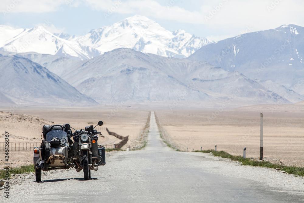 Fototapeta Sidecar riding in the mountains
