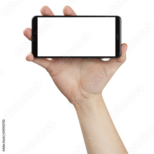 Fotografiet  Hand holding black smartphone, isolated on white background