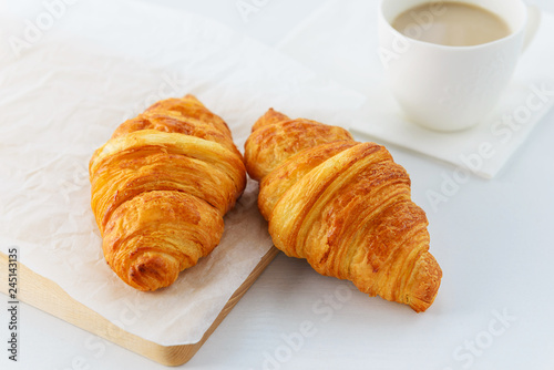 Photo Stands Coffee beans Croissants with a cup of coffee on a wooden board