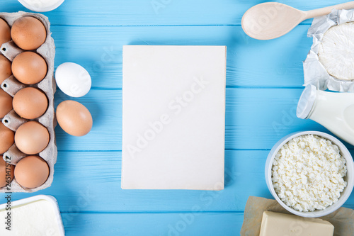 dairy products on blue wooden background