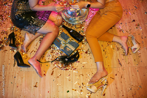 Fotografering  Cropped image of women getting rid of heels after dancing all night at party, ta