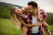 Leinwanddruck Bild - Happy couple having fun outdoor
