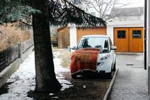 Prato Allo Stelvio, Italy - 03 24 2013: View Of The Streets Of Italian Prato Allo Stelvio In Winter. A Car In The Yard