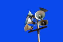 Set Of Street Loudspeakers On A Pole On A Background Blue Sky