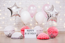 Birthday Party Concept - Close Up Of Air Balloons, Paper Balls And Lightbox With Happy Birtday Text