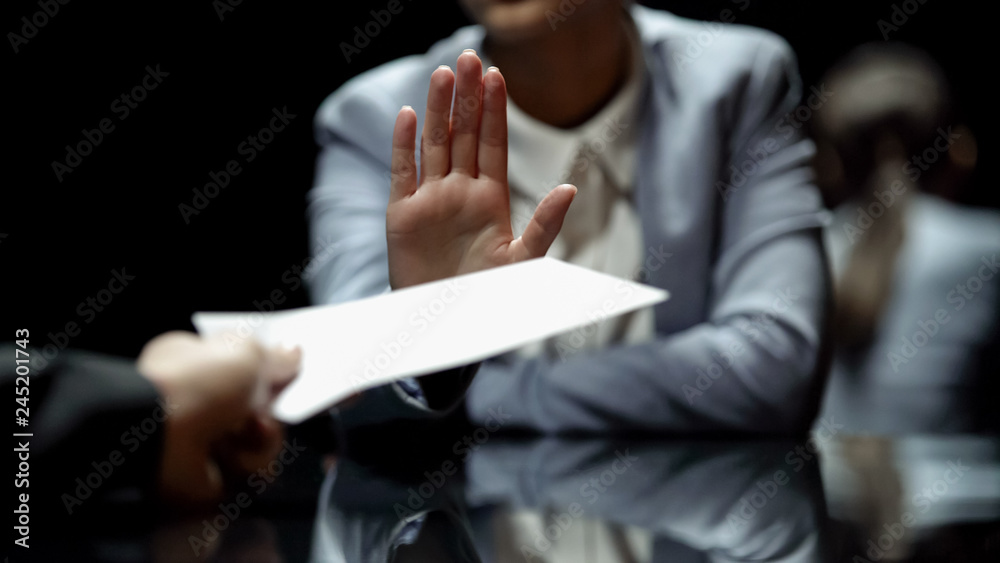 Fototapeta Female official refuses to take bribe, anti-corruption laws in action, close up