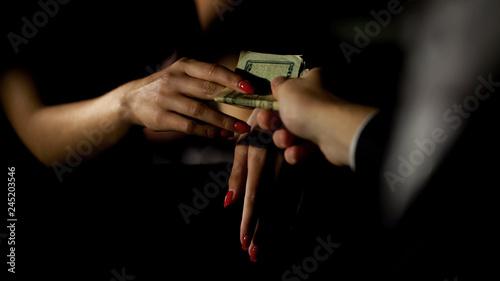 Businessman in car giving money to prostitute, illegal sex trade, female escort Canvas Print