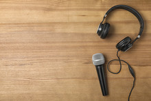 Headphones, Microphone And Space For Text On Wooden Background, Top View