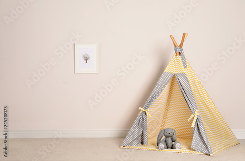 Cozy child room interior with play tent