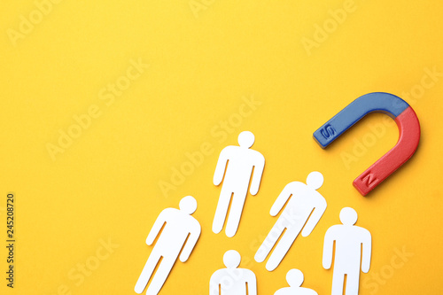 Obraz Magnet attracting people traffic on color background, top view with space for text. Marketing concept - fototapety do salonu
