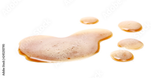 Tuinposter Bier / Cider Spilled beer puddle with foam isolated on white background and texture, clipping path