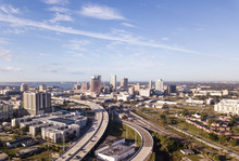 Aerial View Of Downtown Tampa, Florida And Surrounding Highways And Industrial Areas.
