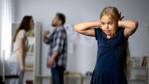 Divorce and children, unhappy little girl suffering quarrels between parents Canvas Print