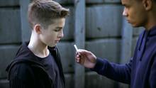 Drug Dealer Boy Treating Young...