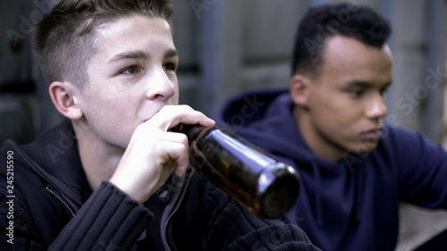 Fotografering  Problem teenagers secretly drinking beer, skipping school classes, hooligans