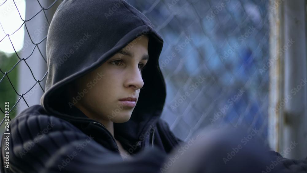 Fototapeta Upset teen suffering school bullying, dysfunctional family, depression concept