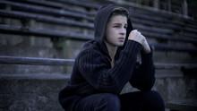 Upset Boy Feels Depression, Sitting On Stadium Tribune, Loneliness And Sorrow