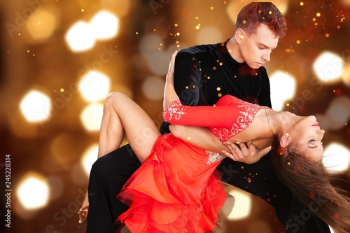 Fotografie, Obraz  Man and a woman dancing Salsa on background