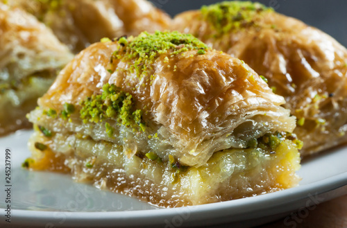Traditional turkish dessert antep baklava with pistachio on white plate Canvas Print