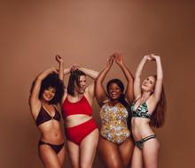 Multi-ethnic Women In Swimwear Enjoying Themselves