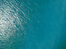Aerial Top View Water Surface Background. Bird Eye Sea Surface Photo. Blue Ocean From Above. Minimal.