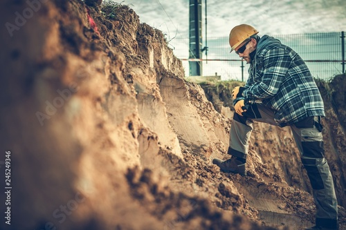 Fotografia, Obraz Worker Checking on a Soil