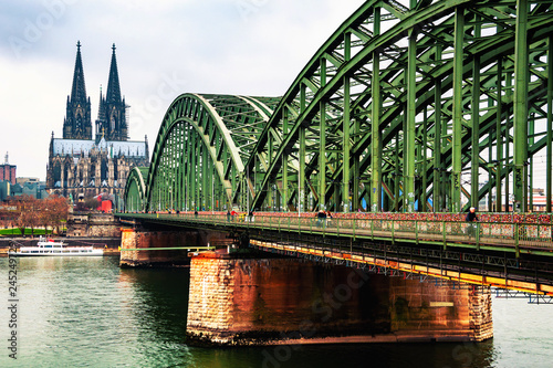Cloudy day view of Cathedral and Hohenzollern bridge in Cologne, Germany