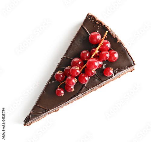 Piece of tasty homemade chocolate cake with berries on white background, top view